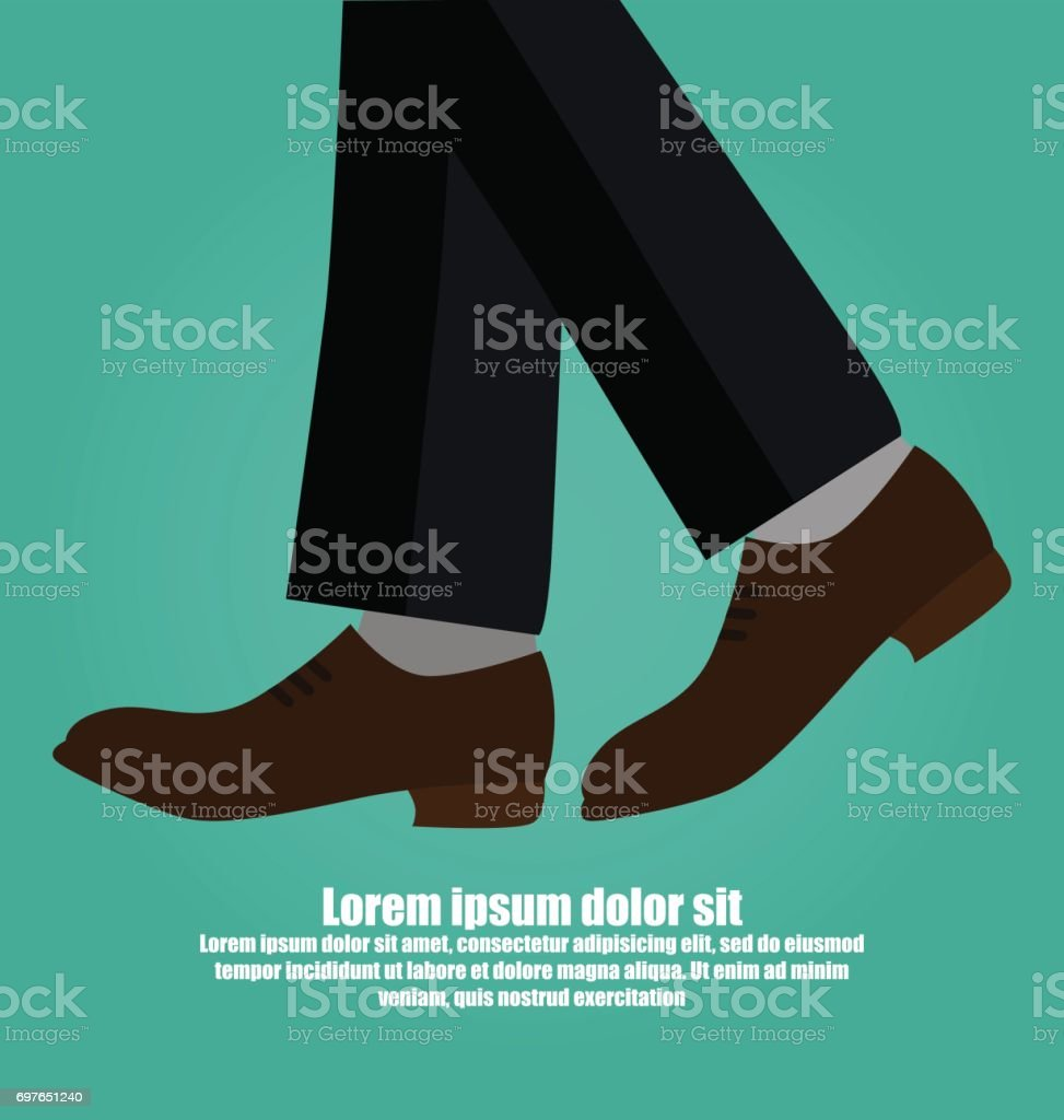 Close-up Of Business Man With Leather Shoes Walking Isolated On Green Background
