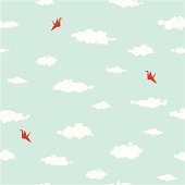 Clouds and origami cranes seamless pattern