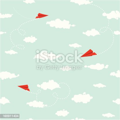 Paper planes with trails flying in the sky with clouds. Seamless pattern.