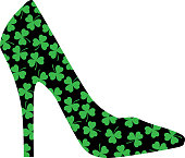 Vector illustration of a black high heel shoe with little green three leaf clovers on them.