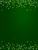 Clover shamrock leaves isolated on dark green background. Abstract St. Patrick's day border background with place for your text for your greeting cards design or poster. Vector illustration
