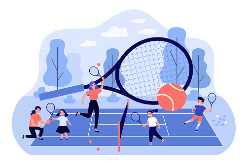 Coaches and children playing at tennis court