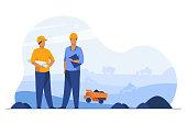 istock Coal mine engineers controlling heavy hydraulic machines 1225779146