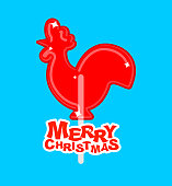 Cockerel candy Merry Christmas. Caramel on stick. Russian traditional folk sweets . lollipop rooster sign for new year. lollipops Cock