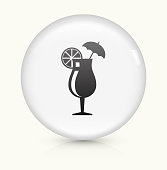 Cocktail Glass Icon on simple white round button. This 100% royalty free vector button is circular in shape and the icon is the primary subject of the composition. There is a slight reflection visible at the bottom.