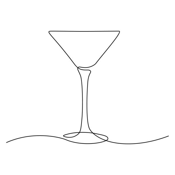Cocktail glass Cocktail glass in continuous line art drawing style. Minimalist black line sketch on white background. Vector illustration martini glass stock illustrations