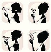 Four elegant women with classic cocktails. Click below for more party and food and drink images