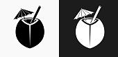 Coconut Cocktail Icon on Black and White Vector Backgrounds. This vector illustration includes two variations of the icon one in black on a light background on the left and another version in white on a dark background positioned on the right. The vector icon is simple yet elegant and can be used in a variety of ways including website or mobile application icon. This royalty free image is 100% vector based and all design elements can be scaled to any size.