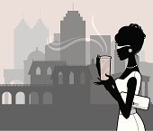 An elegant woman with a take out coffee against a city skyline. Click below for more food and drink images