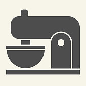 istock Coffee machine solid icon. Mixer with cup symbol, glyph style pictogram on beige background. Kitchen mixer sign for mobile concept and web design. Vector graphics. 1223344699