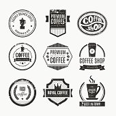 Vector set of coffee shop logos, restaurant or bar logotype design elements with mugs and beans. Ribbons, circle shapes, lables, insignias with coffee related elements. Vintage and retro styled quality badges.