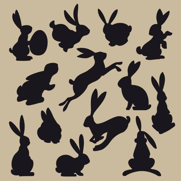 sammlung von schwarze ostern hase silhouetten - kaninchen stock-grafiken, -clipart, -cartoons und -symbole