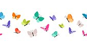 istock Color flying butterflies seamless pattern 1203705914