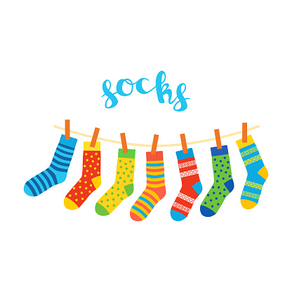 colored socks hanging on a rope