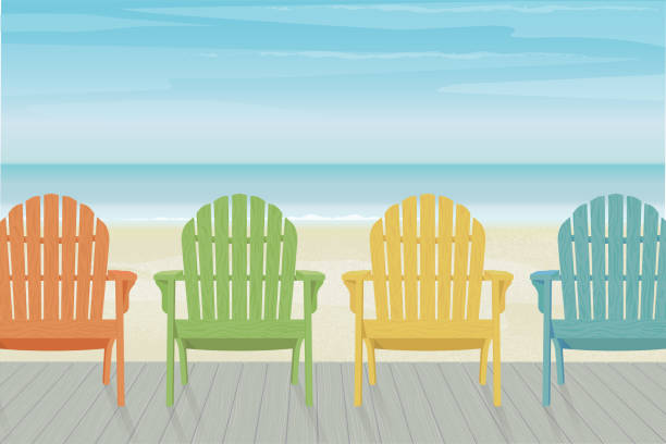 Colorful Adirondack Beach Chairs on Boardwalk Four colorful wooden Adirondack chairs in a row on a wooden deck at the beach. Beautiful and relaxing sky with wispy clouds. outdoor chair stock illustrations