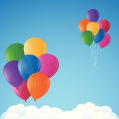 Colorful balloons floating into the sky.