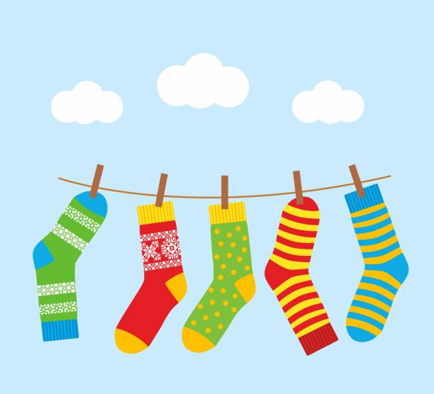 colorful bright socks on a rope with clothespins against - wäscheleine stock-grafiken, -clipart, -cartoons und -symbole