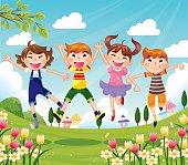 Happy Little Children Jumping outside