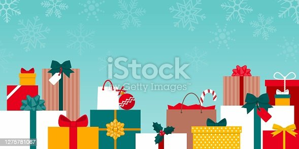 Many colorful Christmas gifts under the snow: holidays and christmas shopping concept