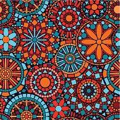 Colorful circle flower mandalas seamless pattern in blue red orange