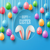 Vector illustration of Colorful easter eggs hanging with bunny ears in egg hole on blue background