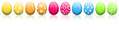 Colorful easter eggs in a row isolated on white background