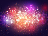 istock Colorful Fireworks Lighting Effect on Purple Background for Celebration Concept. 1199643214