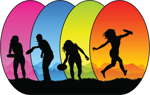 Colorful girls playing frisbee.