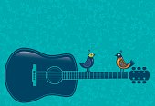 Acoustic guitar with two birds sitting on the neck, with a floral background.