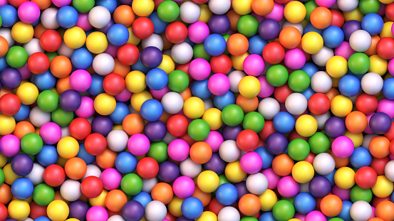 Colorful gumballs background. Assorted brightly colored candy gumballs