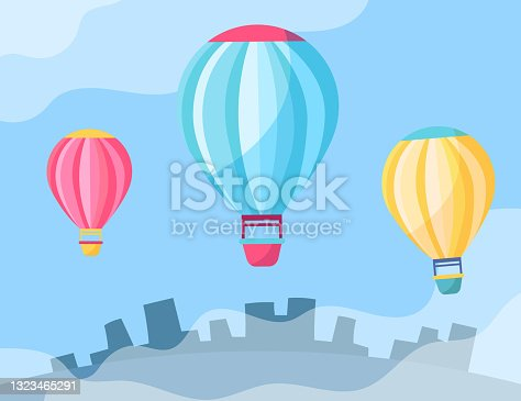 istock Colorful hot air-balloons in sky cartoon illustration 1323465291