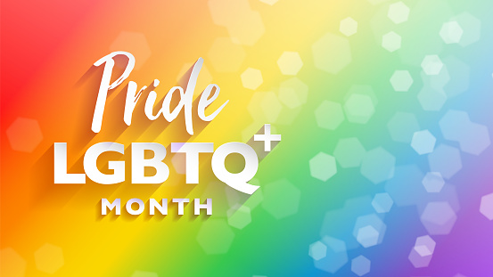 Colorful LGBTQ pride month banner for festival parades and party events. Abstract rainbow bokeh background with copy space.