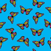 istock Colorful Monarch Butterflies Seamless Pattern 1309631654