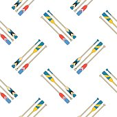 Colorful oars in red, blue, yellow slant on white background. Seamless pattern.