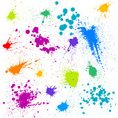 Rainbow paint splatters and design elements