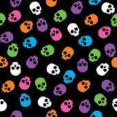 Vector seamless pattern of colorful little human skulls.