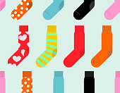 Colorful socks seamless pattern. Vector accessory clothing backg