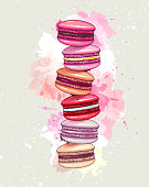 Colorful sweet macarons cakes on artistic watercolor background. French macaroons. Junk food background