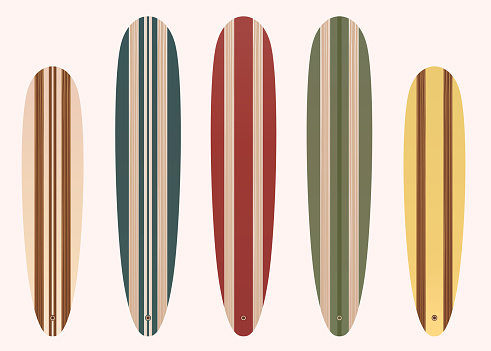 Colorful wooden long surf board collection.