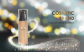 Colorstay make-up in elegant packaging gray background with a bokeh effect and a stream of sparkling dust