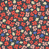 Colourful graphic ditsy gestural blooms and foliage on dark background vector seamless pattern. Floral Texture