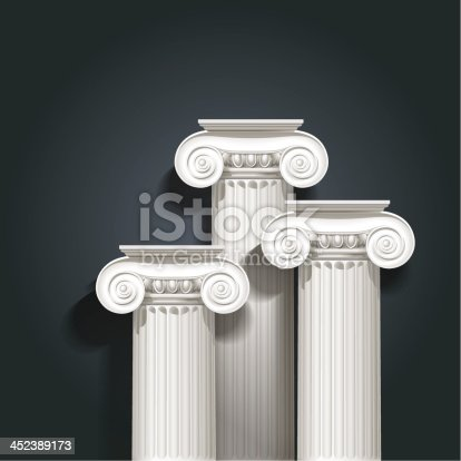 composition of tree columns of ionic order on dark background.