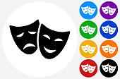 Comedy And Tragedy Masks.The icon is black and is placed on a round blue vector button. The button is flat white color and the background is light. The composition is simple and elegant. The vector icon is the most prominent part if this illustration. There are eight alternate button variations on the right side of the image. The alternate colors are orange, red, purple, yellow, black, green, blue and indigo.