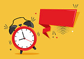 istock Comic cartoon alarm clock and ribbon banner on orange background. Space for your text. Vector 1220233199