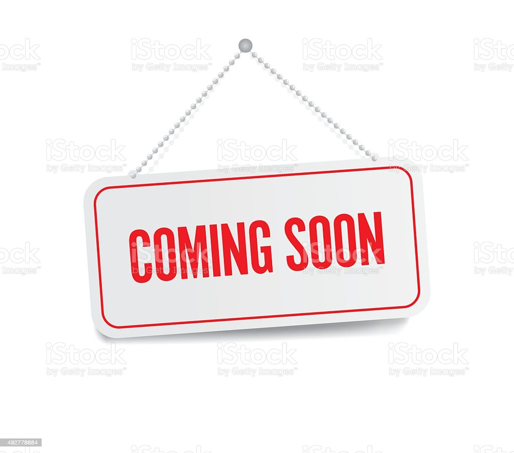 Coming soon sign hanging isolated on white wall