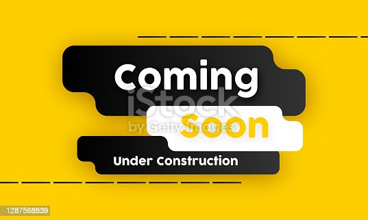 istock Coming soon under construction yellow background design 1287568839