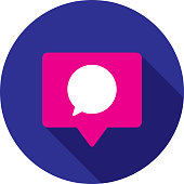 Vector illustration of a comment speech bubble in a pink speech bubble against a blue background in flat style.