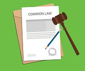 common law concept illustration with gavel and pencil