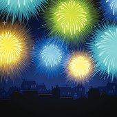 Fireworks display over home skyline.