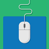 Vector illustration of a computer mouse on a blue mouse pad against a green background in flat style.